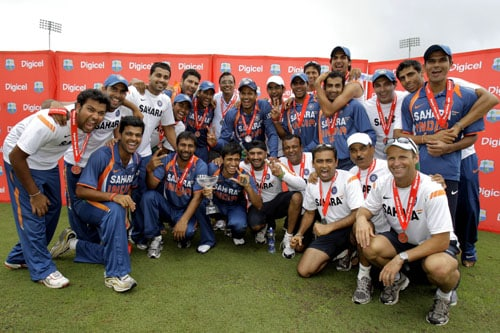 The India's cricket team pose for a photograph with their trophy and medals after winning the One-Day International series against the West Indies at Beausejour in St. Lucia. (AP Photo)