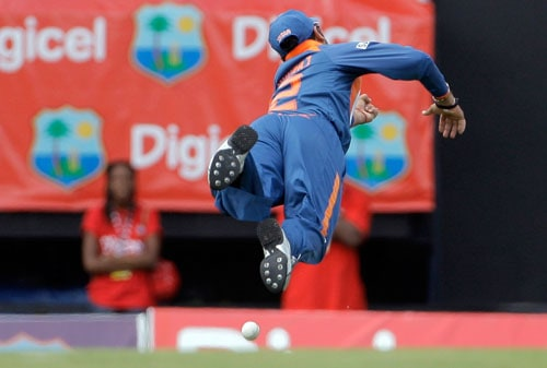 Yuvraj Singh dives but fails to catch a shot off West Indies' opener Runako Morton during the fourth and final One-Day International match at Beausejour in St. Lucia. (AP Photo)