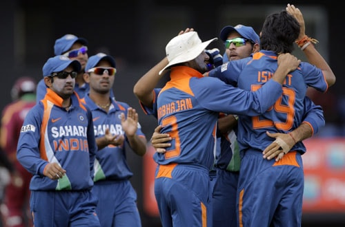 Ishant Sharma is embraced by teammates Yuvraj Singh and Harbhajan Singh after taking the wicket of West Indies' Chris Gayle, who was caught behind for a duck with the second ball of the fourth and final One-Day International match at Beausejour in St. Lucia. (AP Photo)