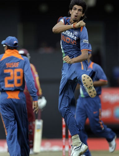 Ishant Sharma jumps into the air in celebration after taking the wicket of West Indies' Chris Gayle, who was caught behind for a duck with the second ball of the fourth and final One-Day International match at Beausejour in St. Lucia. (AP Photo)