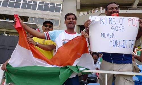 Indian fans cheer their team and display a sign to pay tribute to late music star Michael Jackson during the first ODI between India and the West Indies at Sabina Park. (AP Photo)
