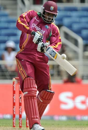 Chris Gayle hits a boundary off Ishant Sharma during the first ODI against India at the Sabina Park. (AFP Photo)