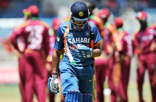 Ravindra Jadeja leaves the field after dismissing off Ravi Rampaul during the second One-Day International match between West Indies and India in Kingston in Kingston. (AFP Photo)