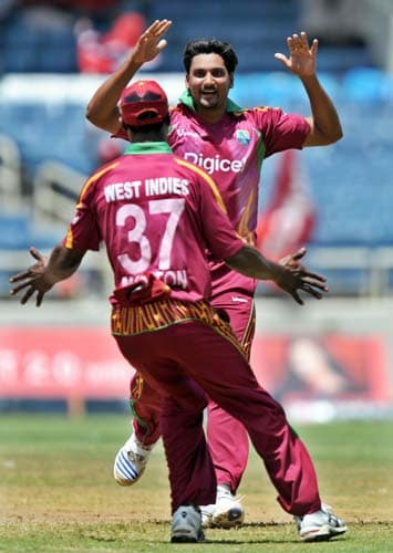 Ravi Rampaul celebrates with a teammate after dismissing Ravindra Jadeja during the second One-Day International match between West Indies and India in Kingston. (AFP Photo)
