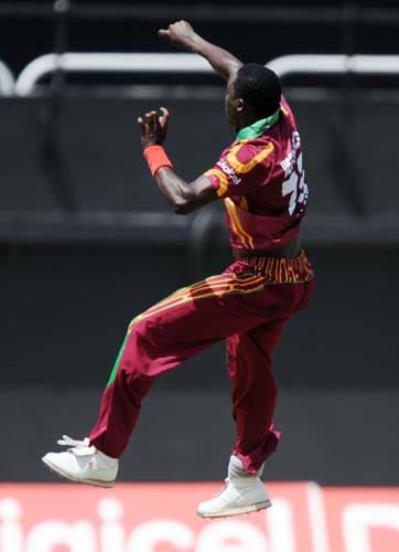 Jerome Taylor celebrates dismissing Yuvraj Singh during the second One-Day International match between West Indies and India in Kingston. (AFP Photo)