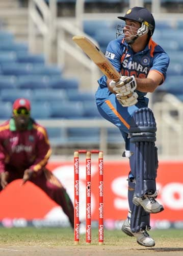 Yuvraj Singh plays a shot off Jerome Taylor during the second One-Day International match between West Indies and India in Kingston. (AFP Photo)
