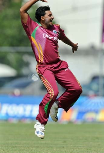 Ravi Rampaul celebrates after dismissing Gautam Gambhir during the second One-Day International match between West Indies and India in Kingston. (AFP Photo)