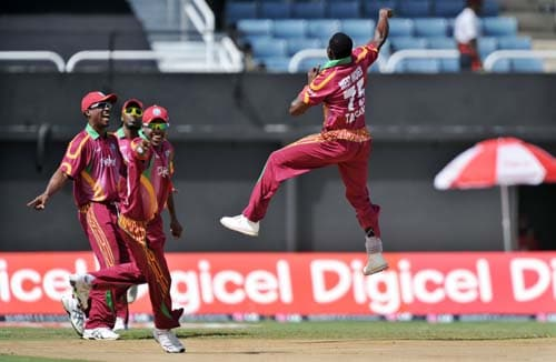 Jerome Taylor leaps in the air as he celebrates dismissing Dinesh Karthik during the second One-Day International match between West Indies and India in Kingston. (AFP Photo)