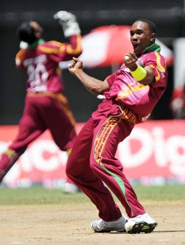 Darren Bravo celebrates after dismissing Harbhajan Singh during the second One-Day International match between West Indies and India in Kingston. (AFP Photo)