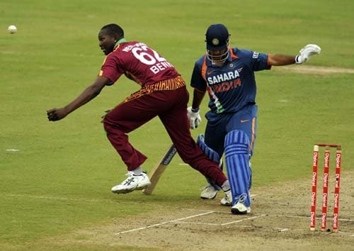 Sulieman Benn goes for a hit past Mahendra Singh Dhoni during the third ODI match at the Beausejour ground in Gros-Islet, St Lucia. (AFP Photo)