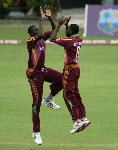 Sulieman Benn and bowler David Bernard celebrates an out on Yuvraj Singh during the third ODI match at the Beausejour ground in Gros-Islet, St Lucia. (AFP Photo)