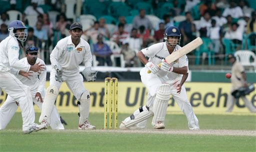 Indian batsman Sourav Ganguly, right, plays a shot as Sri Lankan wicketkeeper Prasanna Jayawardene, second from right, Mahela Jayawardene, third from right and Malinda Warnapura, left, look on during the third day's play of the first cricket Test between Sri Lanka and India in Colombo on Friday, July 25, 2008.