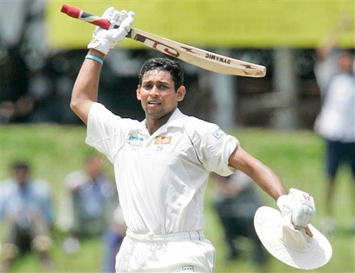 Tillakaratne Dilshan celebrates after scoring a century during the third day's play of the first Test cricket match against India in Colombo on Friday, July 25, 2008.