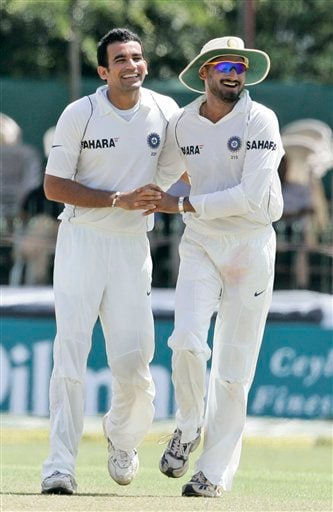 Zaheer Khan, left, celebrates the dismissal of Sri Lankan batsman Thilan Samaraweera, unseen, with teammate Harbhajan Singh during the third day's play of the first Test cricket match between Sri Lanka and India in Colombo on Friday, July 25, 2008.