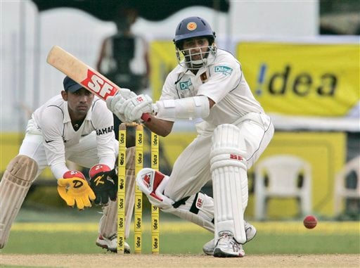 Thilakaratne Dilshan bats as Dinesh Karthik looks on during the third day's play of the first Test cricket match between Sri Lanka and India in Colombo on Friday, July 25, 2008.