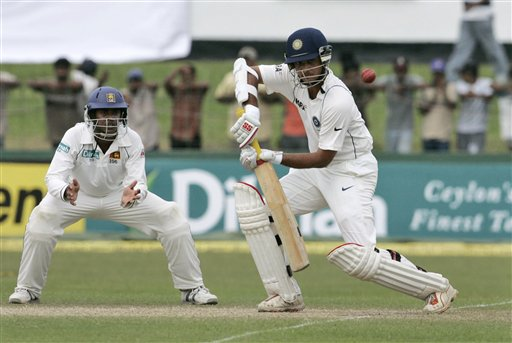 Sourav Ganguly plays a shot as Sri Lankan fielder Malinda Warnapura, left, looks on during the third day's play of the first cricket Test between Sri Lanka and India in Colombo on Friday, July 25, 2008.