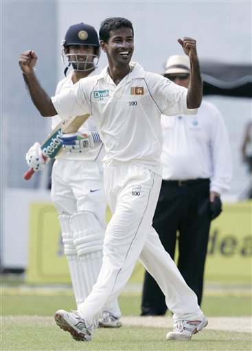 Nuwan Kulasekera celebrates the wicket of Virender Shewag, unseen, as India's non striker Gautam Gambhir looks on during the third day's play of the first cricket Test match between Sri Lanka and India in Colombo on Friday, July 25, 2008.