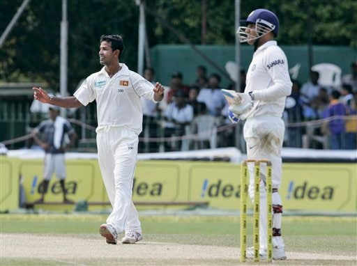 Nuwan Kulasekera, left, celebrates the wicket of Virender Sehwag during the third day's play of the first Test cricket match between Sri Lanka and India in Colombo on Friday, July 25, 2008.