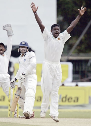 Ajantha Mendis and Prasanna Jayawardene successfully appeal for a leg before the wicket decision against Anil Kumble during fourth day of the first Test between Sri Lanka and India in Colombo, Sri Lanka on July 26, 2008.