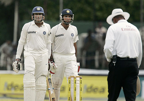 Anil Kumble and VVS Laxman await third umpire's decision on Kumble's leg before the wicket during fourth day of the first Test between Sri Lanka and India in Colombo, Sri Lanka on July 26, 2008.