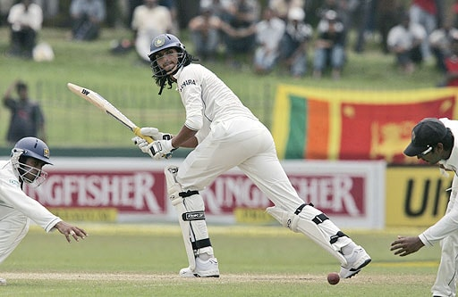 Ishant Sharma bats as Kumar Sangakkara and Malinda Warnapura, try to catch the ball during fourth day of the first Test between Sri Lanka and India in Colombo, Sri Lanka on July 26, 2008.