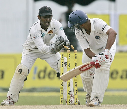 Prasanna Jayawarden removes the bails to unsuccessfully dismiss Rahul Dravid during the fourth day of the first Test between Sri Lanka and India in Colombo, Sri Lanka on July 26, 2008.