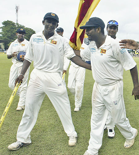 Ajantha Mendis and Muttiah Muralitharan lead the victorious Sri Lankan team back to the pavilion after Sri Lanka beat India by an inning and 239 runs in the Test match in Colombo, Sri Lanka on July 26, 2008.