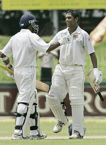 Mahela Jayawardane congratulates Malinda Warnapura as he completes his century during the second day of the first Test against India in Colombo, Sri Lanka on July 24, 2008.
