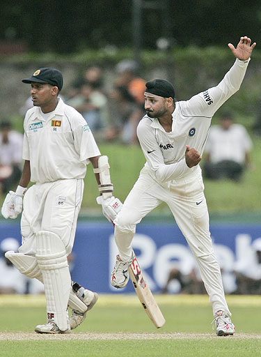 Harbhajan Singh bowls as Thilan Samaraweera looks on during the second day of the first Test match against India in Colombo, Sri Lanka on July 24, 2008.