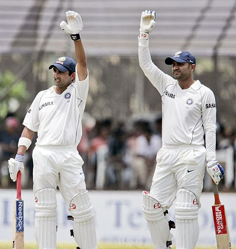 Virender Sehwag and Gautam Gambhir try to get attention of their teammates to change their caps to helmets during the first day of the second Test between India and Sri Lanka at Galle International Cricket Ground in Galle on July 31, 2008.