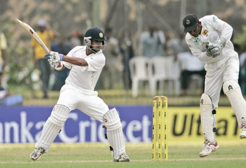Gautam Gambhir bats as Sri Lankan wicket keeper Prasanna Jayawardene looks on during the first day of the second Test between India and Sri Lanka at Galle International Cricket Ground in Galle on July 31, 2008.