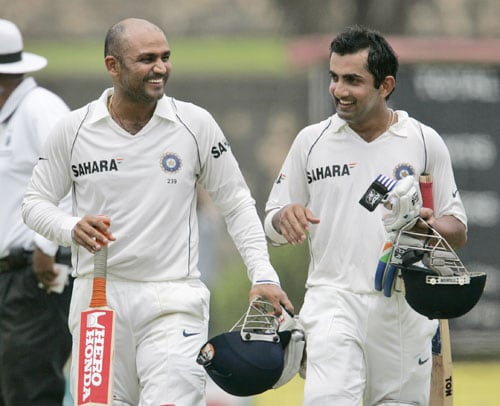 Virender Sehwag and Gautam Gambhir walk back to the pavilion for a lunch break during the first day of the second Test against Sri Lanka at the Galle International Cricket Ground in Galle on July 31, 2008.