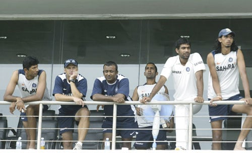Indian cricket team members look on as rain pours at the Galle International Cricket Ground during the first day of the second Test between India and Sri Lanka in Galle on July 31, 2008.