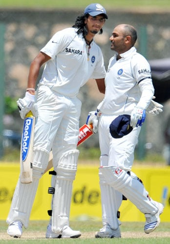 Virender Sehwag is congratulated by teammate Ishant Sharma after completing a double century during the second day of the second Test match between India and Sri Lanka in Galle on August 1, 2008. (AFP Photo)