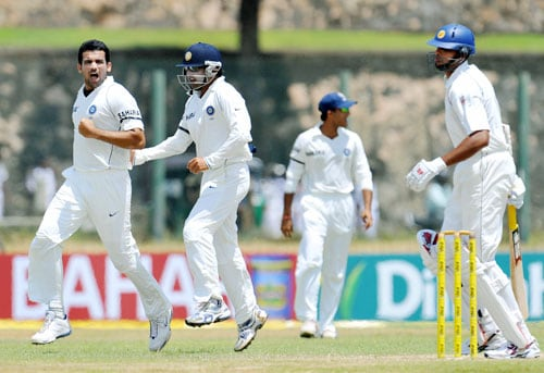 Zaheer Khan celebrates with teammate Gautam Gambhir after the dismissal of Michael Vandort during the second day of the second Test match between India and Sri Lanka in Galle on August 1, 2008. (AFP Photo)