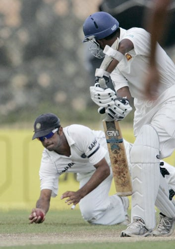 Rahul Dravid takes a catch as Prasanna Jayawardene looks on during third day of the second Test between India and Sri Lanka in Galle on August 2, 2008.