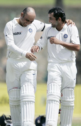 Virender Sehwag and Gautam Gambhir take a water break during third day of the second Test between India and Sri Lanka in Galle on August 2, 2008.