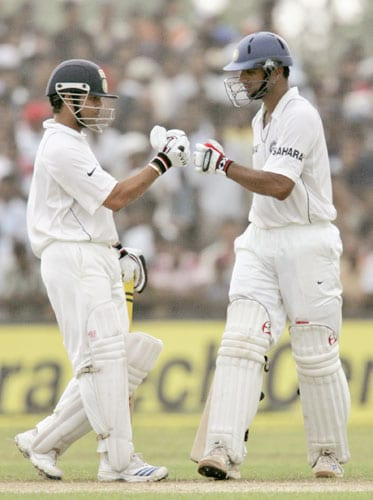 Sachin Tendulkar and Rahul Dravid congratulate each other during the third day of the second Test between India and Sri Lanka in Galle on August 2, 2008.