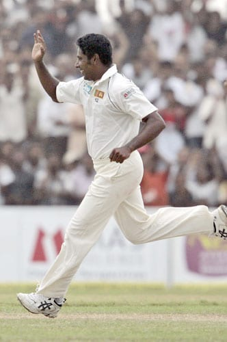 Chaminda Vaas celebrates the dismissal of Sachin Tendulkar during the third day of the second Test between India and Sri Lanka in Galle on August 2, 2008.