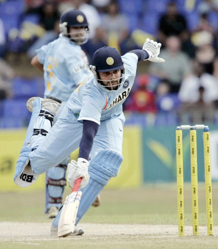Virat Kohli completes a single as non-striker Gautam Gambhir looks on during the third One-Day International of five match series against India in Colombo.