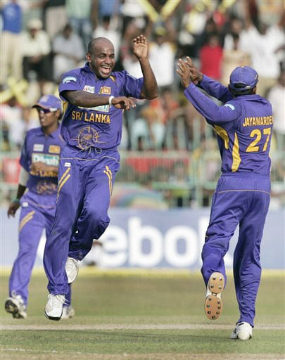 Sanath Jayasuriya with teammates celebrates the dismissal of Suresh Raina during the third One-Day International of five match series against India in Colombo.