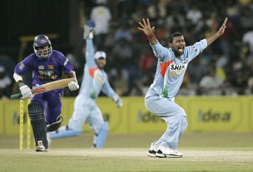 Praveen Kumar successfully appeals for the wicket of Chamara Kapugedera during the third One-Day International of five match series against Sri Lanka in Colombo.