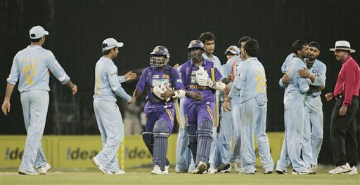 Members of the Indian cricket team shake hands with Sri Lankan batsmen Muttaiah Muralitharan and Ajantha Mendis after India beat Sri Lanka by 33 runs in the third One-Day International of five match series in Colombo.