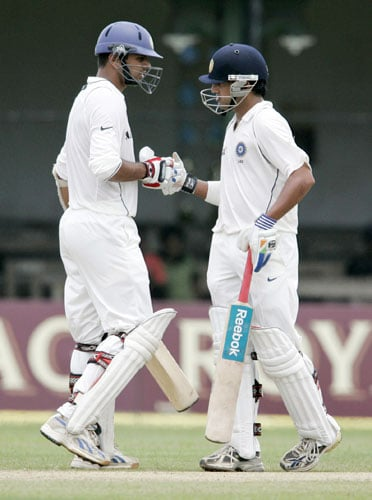 Rahul Dravid congratulates teammate Gautam Gambhir for completing a half-century during the first day of the third Test between India and Sri Lanka in Colombo on August 8.