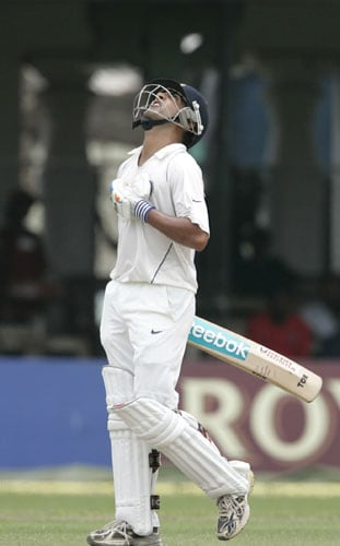 Gautam Gambhir looks skyward after scoring a half century during the first day of the third Test between India and Sri Lanka in Colombo on August 8.