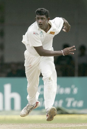 Ajantha Mendis bowls during the first day of the third Test between India and Sri Lanka in Colombo on August 8.
