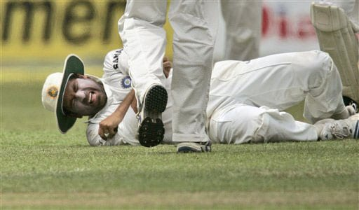 Sachin Tendulkar winces in pain after he was injured while attempting a catch during the second day of the third Test between India and Sri Lanka in Colombo on August 9, 2008.