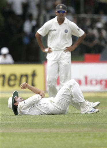 Sachin Tendulkar lies on the ground after being injured while attempting a catch during the second day of the third Test between India and Sri Lanka in Colombo on August 9, 2008.