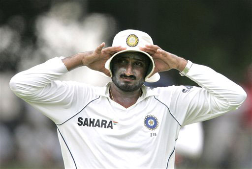 Harbhajan Singh shields his face from the heat with his hat to avoid heat during the second day of the third Test between India and Sri Lanka in Colombo on August 9, 2008.
