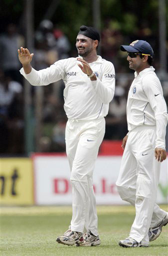 Harbhajan Singh celebrates with team mate Gautam Gambhir the dismissal of Chaminda Vaas during the second day of the third Test between India and Sri Lanka in Colombo on August 9, 2008.